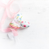 Easter Eggs with Pink Ribbon on white painted wood - 191030639