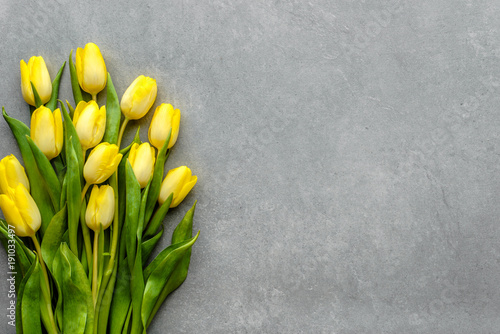Fototapeta Yellow tulips, spring easter background or anniversary gift for mothers day or card for women's day at 8 march