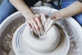 Ceramic studio, craft working process with clay potter's wheel, close-up of hands doing object - 191034811
