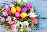 Happy Easter: nest with Easter eggs, feathers, tulips and daffodils:) - 191039026