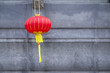 Chinese red lantern in a Thai-Chinese temple on grey background as an up-coming Chinese new year celebrate decoration with blank side copy space.