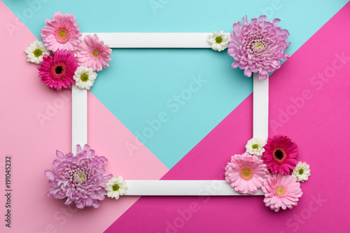 Happy Mother's Day, Women's Day, Valentine's Day or Birthday Pastel Candy Colours Background. Floral flat lay minimalism geometric patterns greeting card.