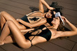 Fashion Women In Swimsuits Relaxing In Summer.