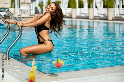 Pool Fashion. Woman In Pool In Summer