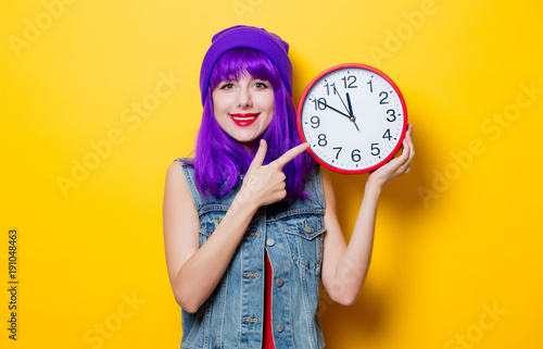 hipster girl with purple hair with big clock