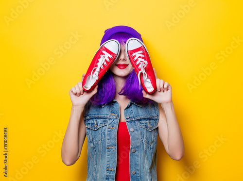 hipster girl with purple hair and red gumshoes