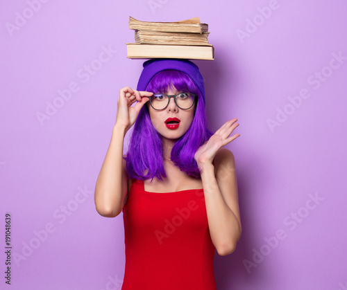 girl with purple hair and books