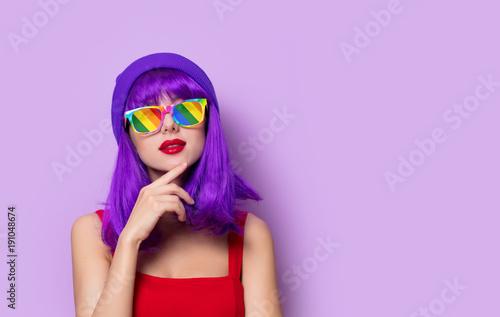 girl with purple hair and rainbow eyeglasses