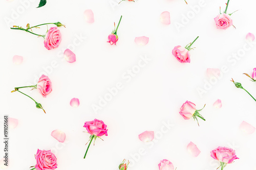 Stylish frame made of pink roses and petals on white background. Floral pattern. Flat lay, Top view.