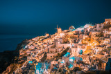 Santorini Oia Greece during vacation with a view at the white washed village with beautiful greek church - 191054006