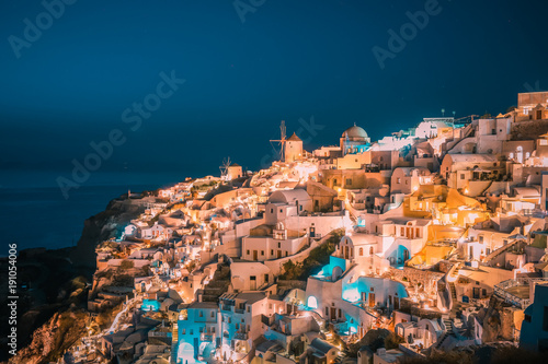 Staande foto Zalm Santorini Oia Greece during vacation with a view at the white washed village with beautiful greek church