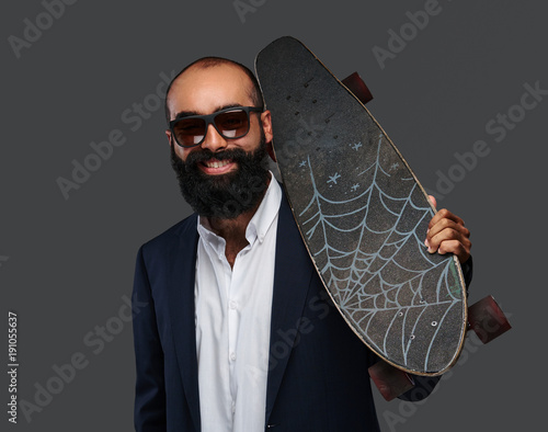 Fotobehang Skateboard Portrait of a bearded male isolated on grey background.