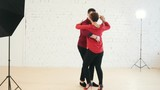 Middle age female and young man in red shirt is dancing kizomba in studio - 191063439