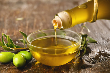 Genuine Italian olives organic oil cold pressed  falls. concept of nature and healthy food, healthy and natural. fresh olives and Tuscan Italian oil