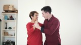 Happy and attractive family couple in love dance together in studio - 191064678
