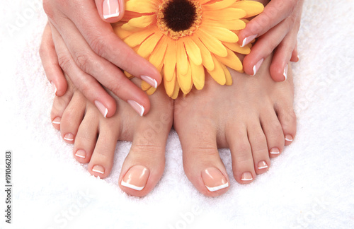 Papiers peints Pedicure Closeup photo of a beautiful female feet with pedicure