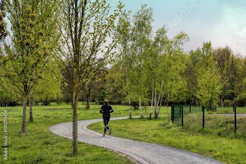 Fotobehang Hardlopen Joggen im Park