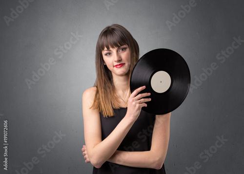 Fotobehang Muziek Lady holding vinyl record