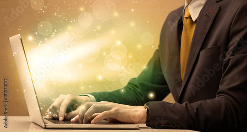 Businessman working fast on laptop