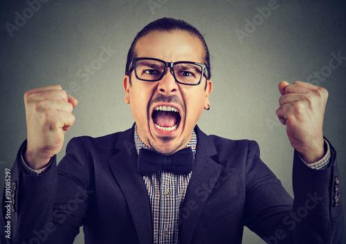 Formal man screaming in anger
