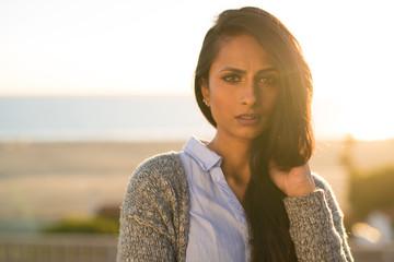 Young Indian woman serious face sunset