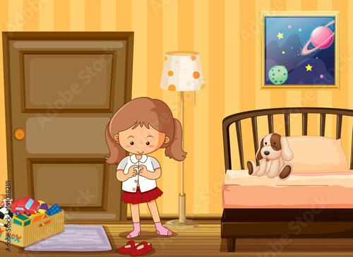 Keuken foto achterwand Kids Girl dressing up in school uniform in bedroom