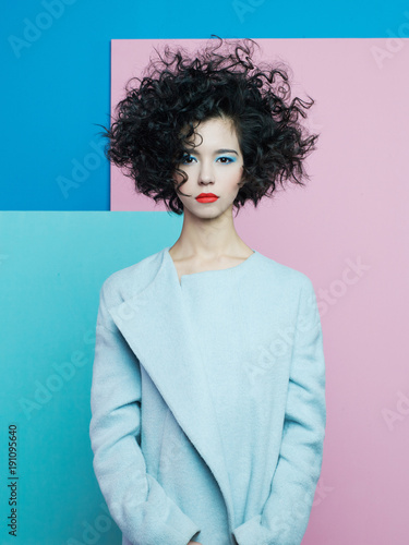 Fotobehang womenART Fashion portrait of beautiful asian woman in sky-blue coat