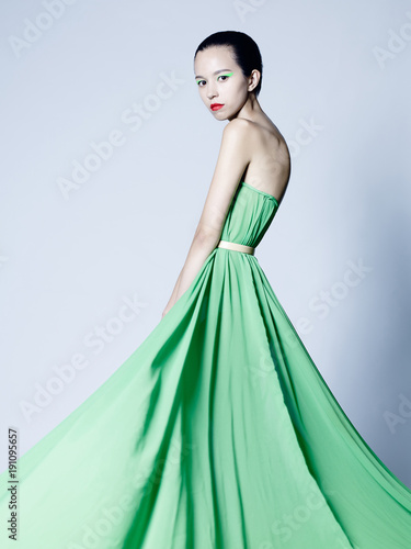 Fotobehang womenART Beautiful asian woman in green dress