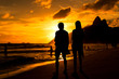 Quadro Silhouette of a Couple Walking in Ipanema Beach in Rio de Janeiro by Sunset with Mountains in Background
