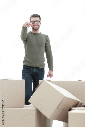 smiling man showing keys of new apartments