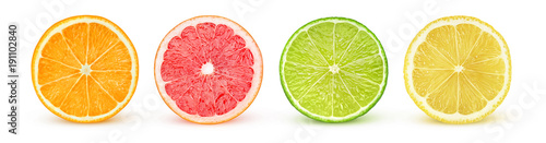 Isolated citrus slices. Fresh fruits cut in half (orange, pink grapefruit, lime, lemon) in a row isolated on white background with clipping path - 191102840