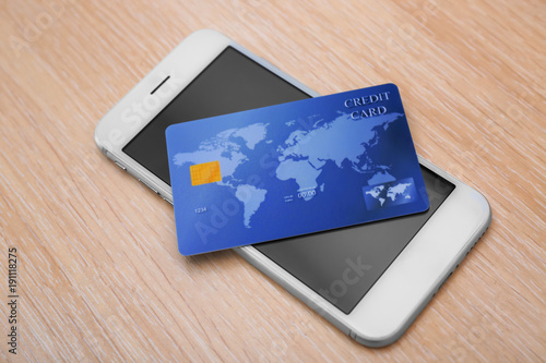 Credit card and mobile phone on table. Internet shopping concept