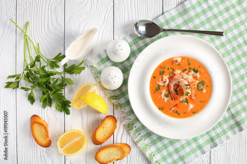 Fototapeta hot bisque of shredded alaskan crab meat