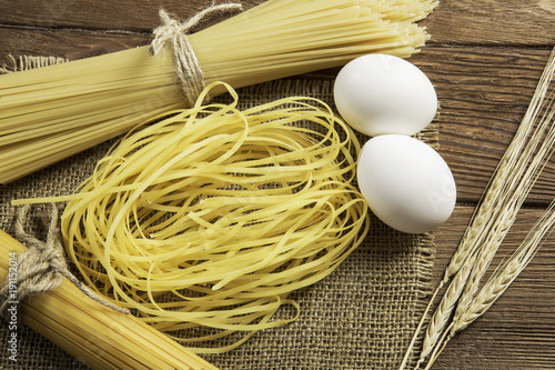 Dry pasta on table