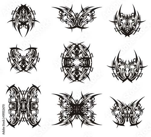 Abstract peaked symbols in the butterfly form. Stylized fantastic ethnic symbols of butterflies and bugs formed by the head of an eagle. Black on white
