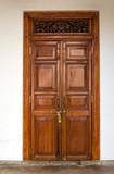 Old wooden brown house door