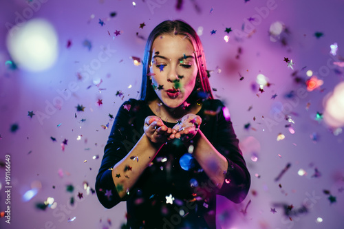Celebration girl. Portrait of young dancing party girl