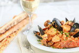 risotto with seafood and tomato, italian food - 191170086