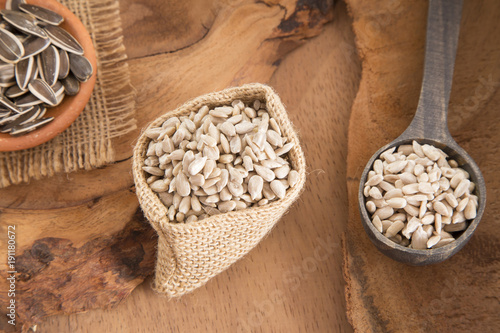 Fototapeta Sunflower seeds in shell and peeled