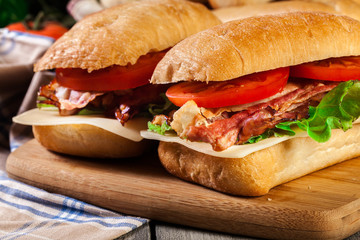 Ciabatta sandwich with smoked bacon, cheese and tomato