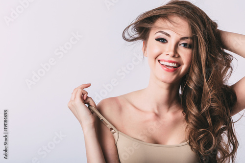 Woman. Smiling girl with long healthy hair.