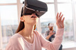 Objects in air. Fascinated cute nice woman touching VR panel while looking up and opening mouth