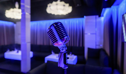 Retro microphone on stage in a pub