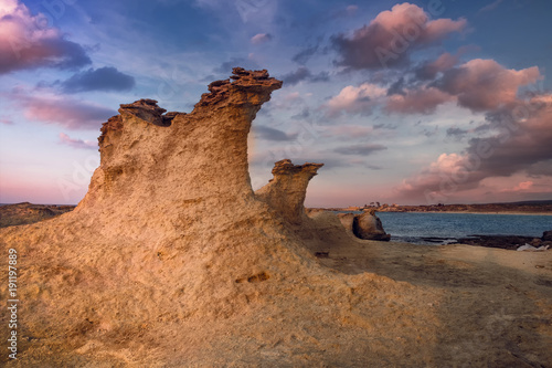 Foto op Canvas Cyprus Beatiful Cyprus sunset on the desert empty rocky coast with strange fiqures at the Halk beach