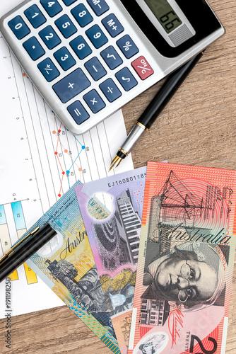 Concept Australian Dollar Graph Calculator Pen Close Up