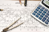 architectural construction documents with pen and calculator - 191203086