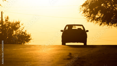 Tuinposter Meloen car rides on the road at sunset