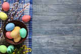 Colorful easter eggs on wood background - 191210234