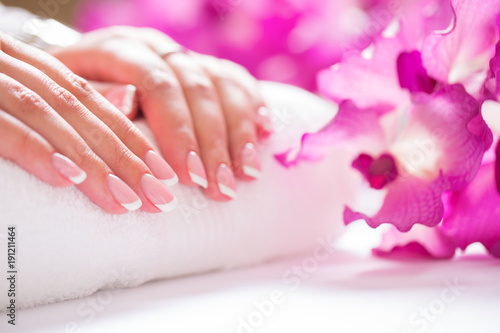 Fotobehang Spa Closeup shot of beautiful female dands with nails of france manicure. Manicure and spa concept