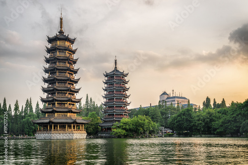 Tuinposter Guilin The Sun and Moon Twin Pagodas at sunset, Guilin, China